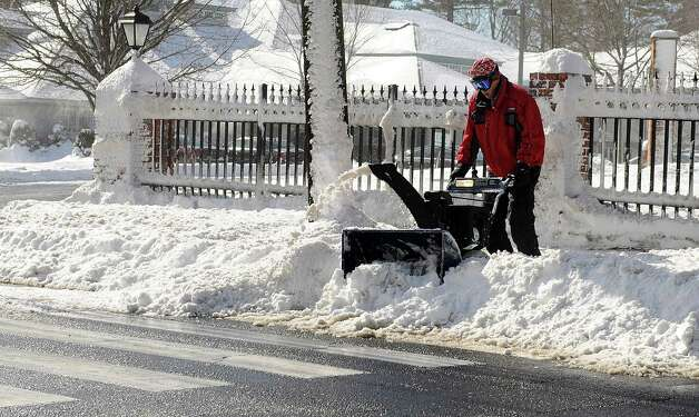 A man uses a snowblower in Stamford, Conn., on Saturday, February 9, 2013. Photo: Lindsay Perry / Stamford Advocate