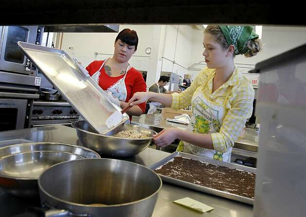 Leah (left) and Stephanie Melnik work on a batch of their Awesome granola bars Thursday February 7, 2013. Sisters Leah and Stephanie Melnik make unique granola bars in a San Francisco, Calif. kitchen that combine natural ingredients and are good tasting. Photo: Brant Ward, The Chronicle