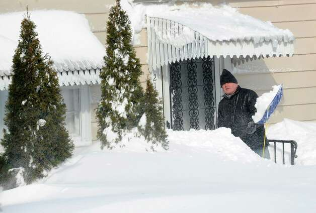 Robbert Button starts to dig out of his Burroughs Rd. home  in Fairfield, Conn. on Saturday, Feb. 9, 2013. Southwestern Connecticut was hit by one of the biggest snowstorms in history, a howling blizzard that dumped over two feet of snow across area. Photo: Cathy Zuraw / Connecticut Post