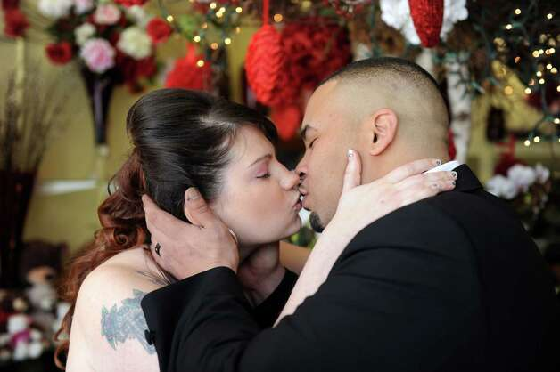 Amy Troiano and Omar Velez marry at Stamford Florist on Saturday, February 9, 2013. Photo: Lindsay Perry / Stamford Advocate