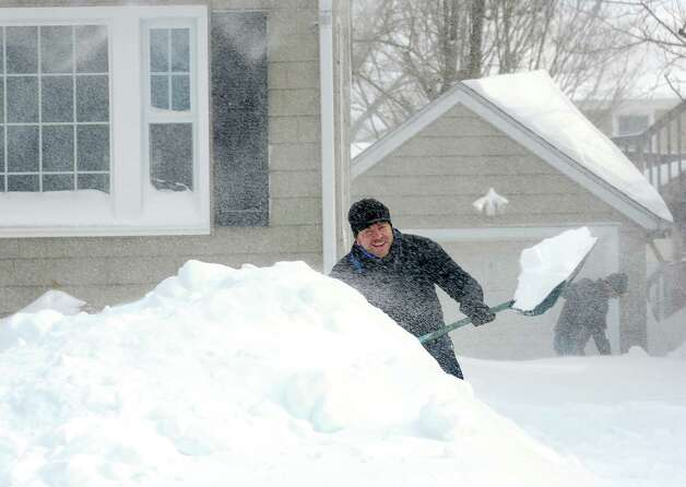 Burroughs Rd. resident Darren Wagner and his friend Bob Nolan dig out after an overnight blizzard dumped over two feet of snow on Fairfield, Conn. on Saturday, Feb. 9, 2013. Southwestern Connecticut was hit by one of the biggest snowstorms in history. Photo: Cathy Zuraw / Connecticut Post