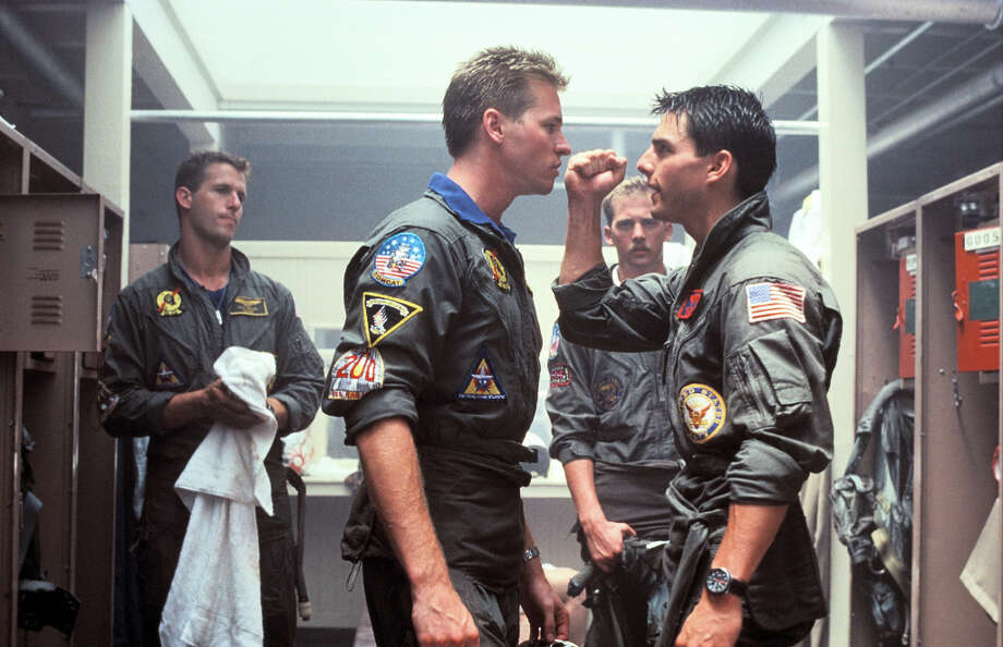 """You can be my wingman anytime.""— Iceman to Maverick in ""Top Gun.""PHOTO: Iceman (Val Kilmer) stares down Maverick (Tom Cruise) in a scene from ""Top Gun."" Photo: 1996-98 AccuSoft Inc. / Courtesy of Paramount Pictures"