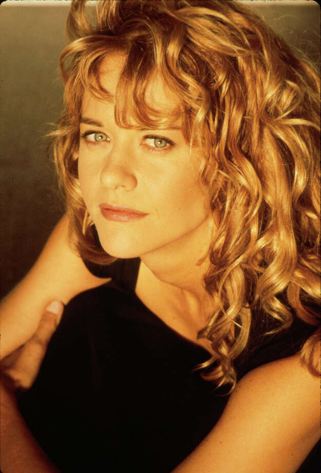 """''""""Top Gun""""'' starred a then-mostly unknown Meg Ryan, who played Goose''s cute wife Carole and had the line, ''""""Take me to bed or lose me forever!""""'' Meg Ryan is pictured in 1986, the year the movie came out. Photo: Time Life Pictures, Time & Life Pictures/Getty Image / Time Life Pictures"""