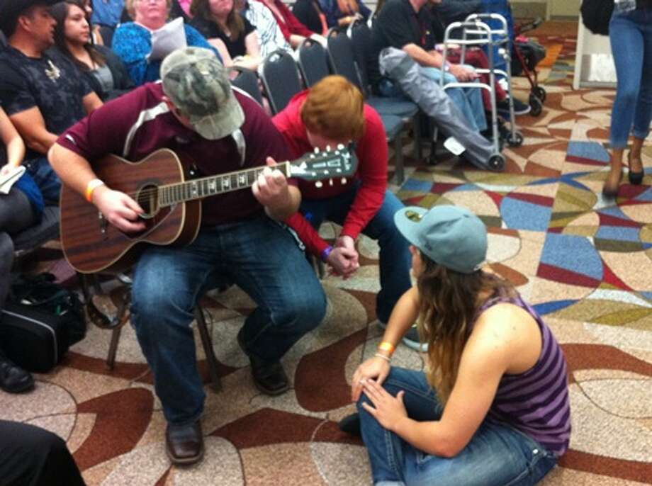 Impromptu concerts inside the holding rooms. (Joey Guerra/Chronicle)