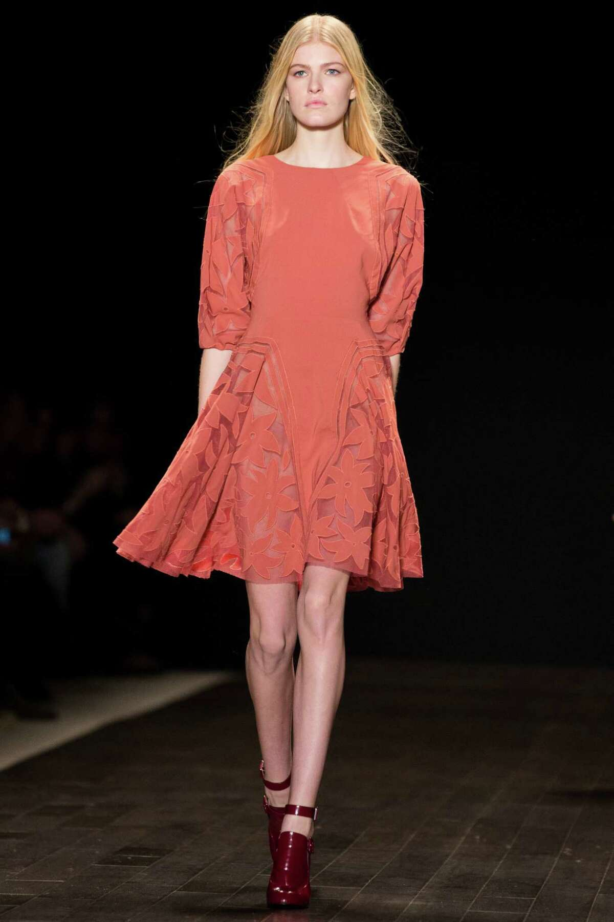 A model walks the runway at the presentation of the Jill Stuart fall 2013 fashion collection.