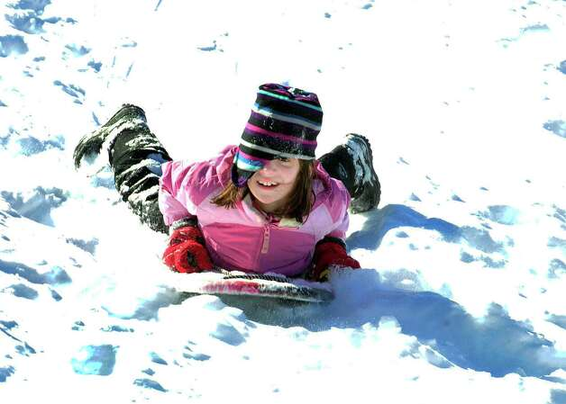 Margaret Swenson, 9, gets a wild ride behind St. Gregory the Great Church in Danbury Saturday, Feb. 9, 2013. Photo: Michael Duffy / The News-Times