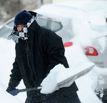 Gabe Quino digs out on Jeniford Rd. after a overnight blizzard dumped over teo feet of snow in Fairfield, Conn. on Saturday, Feb. 9, 2013. Southwestern Connecticut was hit hard by one of the biggest snowstorms in history. Photo: Cathy Zuraw / Connecticut Post