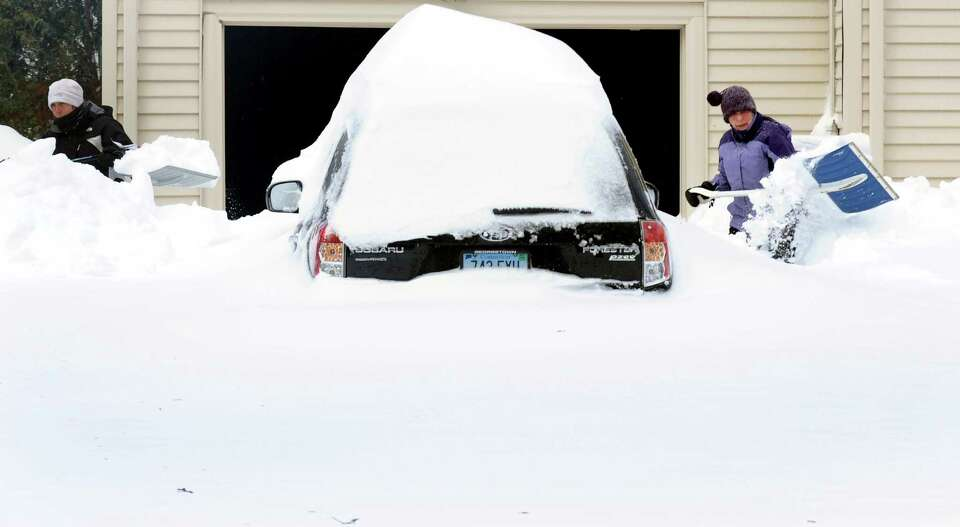 Deb Bross and her mom Sue Bross shovel their driveway on Katona Dr. in Fairfield, Conn. on Saturday,