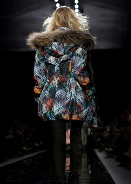 A model walks the runway during the Nicole Miller Fall 2013 fashion show during Fashion Week, Friday