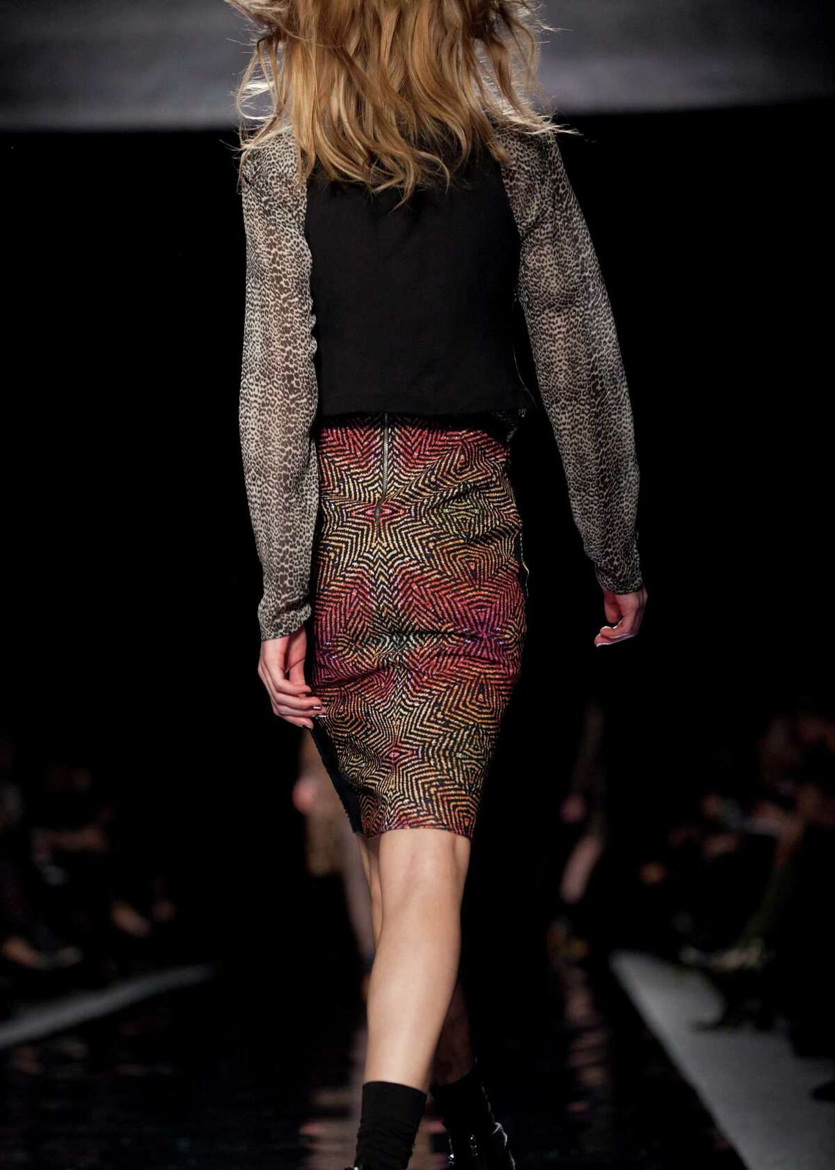 A model walks the runway during the Nicole Miller Fall 2013 fashion show during Fashion Week, Friday, Feb. 8, 2013, in New York.