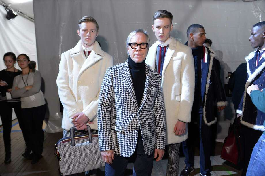 NEW YORK, NY - FEBRUARY 08:  Fashion designer Tommy Hilfiger (C) poses with models backstage at the Tommy Hilfiger Men's Fall 2013 fashion show during Mercedes-Benz Fashion Week at Park Avenue Armory on February 8, 2013 in New York City.  (Photo by Michael Loccisano/Getty Images) Photo: Michael Loccisano, Staff / 2013 Getty Images