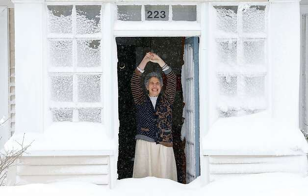 A woman reacts to the snow after opening her front door on February 9, 2013 in Boston, Massachusetts. The powerful storm has knocked out power to 650,000 and dumped more than two feet of snow in parts of New England. Photo: Jared Wickerham, Getty Images
