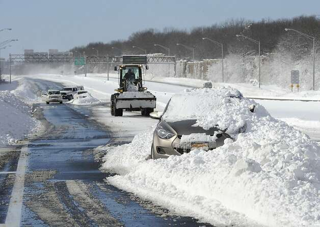 Abandoned cars on the Long Island Expressway after a snow storm on Saturday, Feb. 9, 31, 2013 in Islandia, N.Y. Photo: Kathy Kmonicek, Associated Press