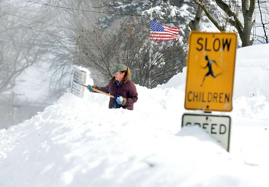 Sandra Pederzini shovels her driveway on Judd St. in Fairfield, Conn. on Saturday, Feb. 9, 2013. Southwestern Connecticut was hit by one of the biggest snowstorms in history, a howling blizzard that dumped up to three feet of snow across the state. Photo: Cathy Zuraw