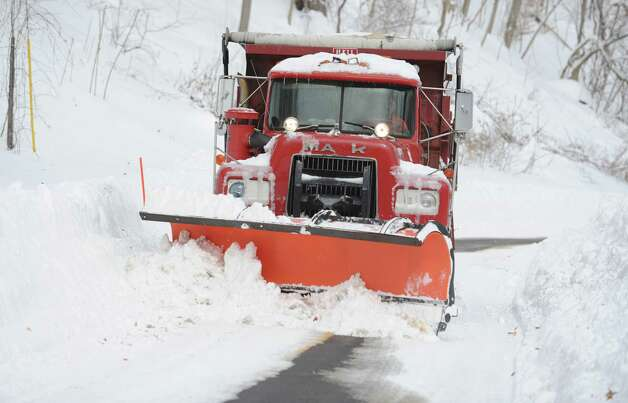 A plow truck pushes snow on Coon Hollow Road in Derby, Conn. Saturday, Feb. 9, 2013 following a severe blizzard that dumped up to three feet of snow across the state. Photo: Autumn Driscoll