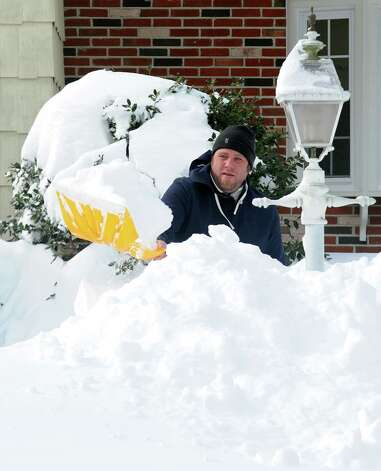 Billy Shaw digs out on High St.after an overnight blizzard dumped over two feet of snow in Fairfield, Conn. on Saturday, Feb. 9, 2013. Southwestern Connecticut was hit by one of the biggest snowstorms in history, a howling blizzard that dumped up to three feet of snow across the state. Photo: Cathy Zuraw / Connecticut Post