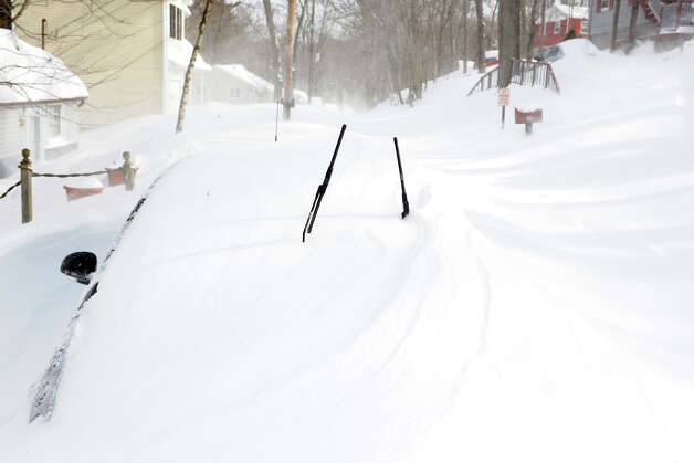 A car covered by a snow drift on Circle Dr., in Stratford, Conn., Feb. 9th, 2013. Photo: Ned Gerard