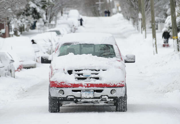 A truck covered in snow navigates a snowy South Water Street during the aftermath of the blizzard that hit Greenwich, Conn., Saturday morning, Feb. 9, 2013. Photo: Bob Luckey / Greenwich Time