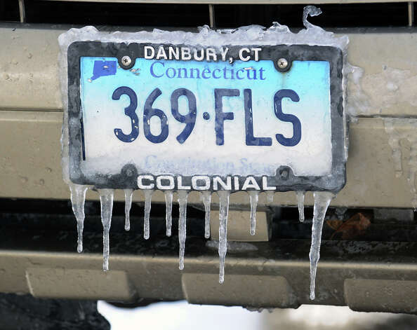 A Connecticut license plate covered in ice during the aftermath of the blizzard that hit Greenwich, Conn., Saturday morning, Feb. 9, 2013 Photo: Bob Luckey / Greenwich Time
