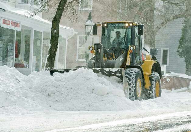 Heavy equipment clears Main Street near Town Hall in Ridgefield after the snowstorm. Saturday, Feb. 9, 2013 Photo: Scott Mullin / The News-Times Freelance