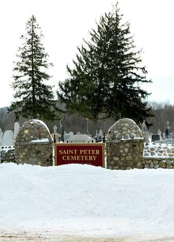 St. Peter's Cemetery is buried in snow along Kenosia Avenue in Danbury Saturday, Feb. 9, 2013. Photo: Michael Duffy / The News-Times