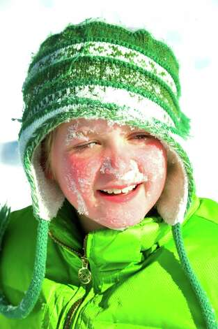 Caroline Williams, 10, gets a face full of snow while sledding behind St. Gregory the Great Church in Danbury Saturday, Feb. 9, 2013. Photo: Michael Duffy / The News-Times