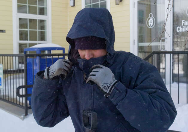 Danny Fernando bundles up before clearing out snow from the Family & Children's Aid child guidance center parking lot on West Street in Danbury on Saturday, Feb. 9, 2013. Photo: Jason Rearick/The News Times, Jason Rearick / The News-Times