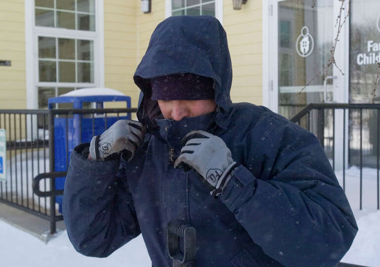 Danny Fernando bundles up before clearing out snow from the Family & Children's Aid child guidance c