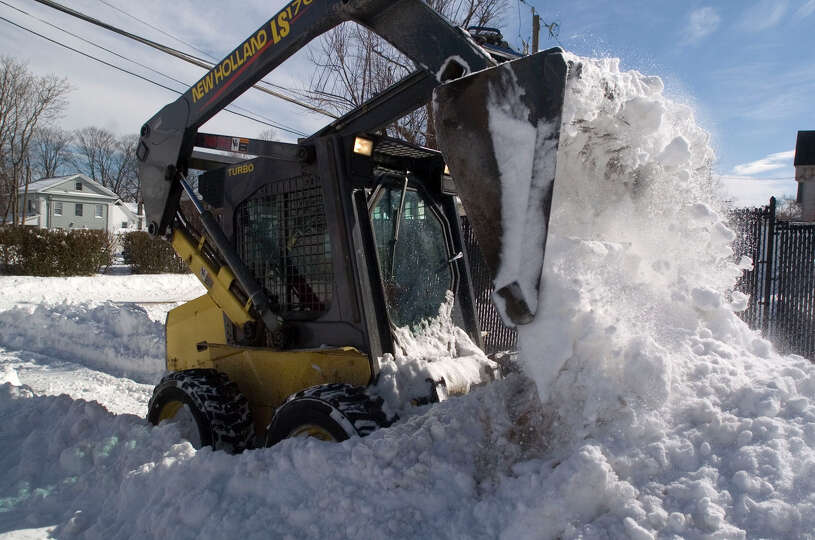 Barry Pritchard clears out snow from the Family & Children's Aid child guidance center parking lot o