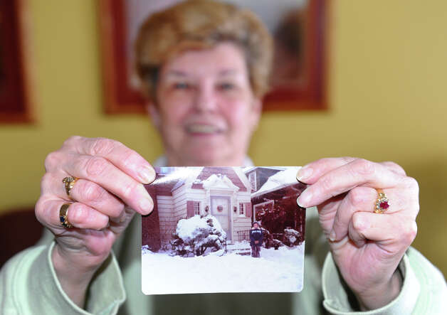 Rosie Kelly shows a picture of herself from the Blizard of 1978 as she enjoys a blizzard party with friends at the Savin Beach Condo complex on Beach Street after a blizzard pounded the region in West Haven, Conn. on Saturday February 9, 2013. Photo: Christian Abraham / Connecticut Post