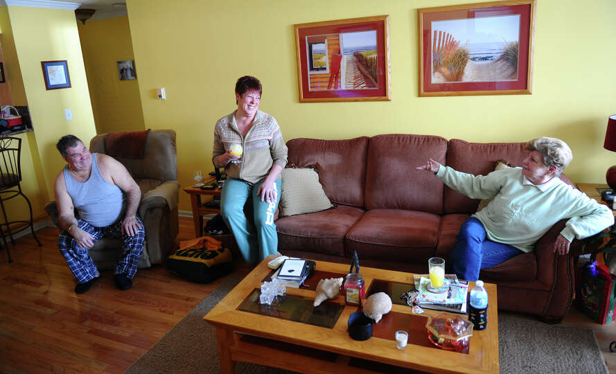 Residents Nancy and Lou Tagliatele, left, hold a blizard party at their home with Rosie Kelly, right
