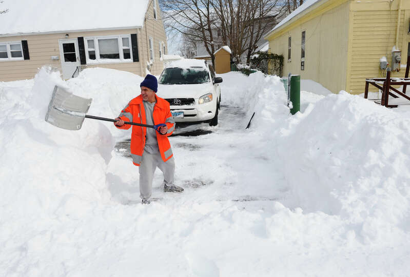 Resdident Ed Valente shovels his driveway after a blizzard pounded the region in West Haven, Conn. o