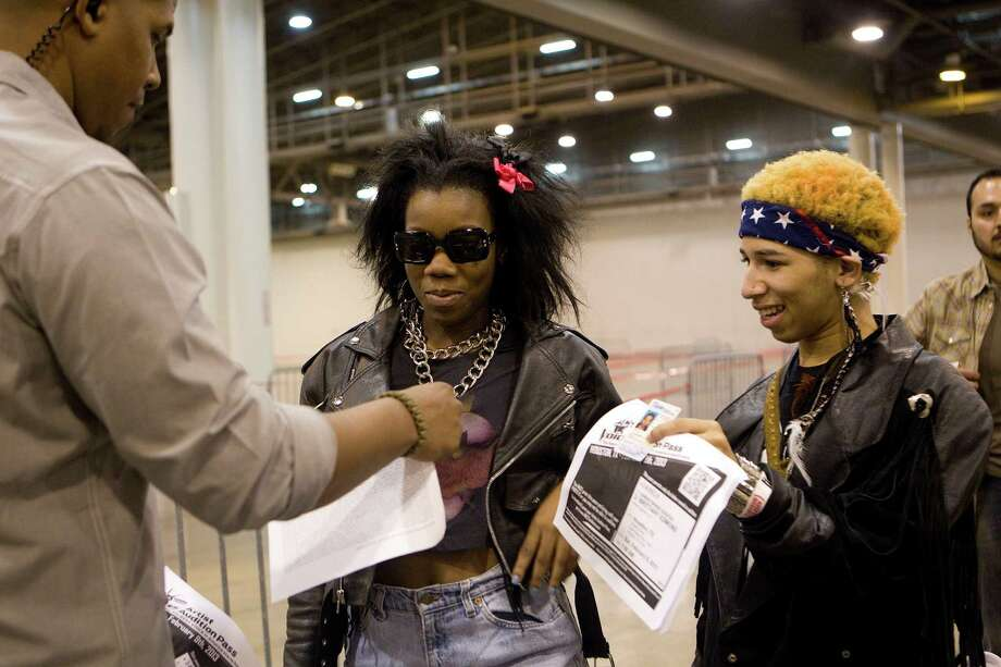 "Calling themselves ""The Social Misfits,"" Wednesday, left, and Soda Pop, right, from Dallas, have their IDs checked. Photo: Johnny Hanson, Houston Chronicle / © 2013  Houston Chronicle"