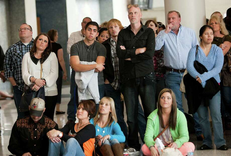 Family and friends wait for their loved ones at the auditions. Photo: Johnny Hanson, Houston Chronicle / © 2013  Houston Chronicle