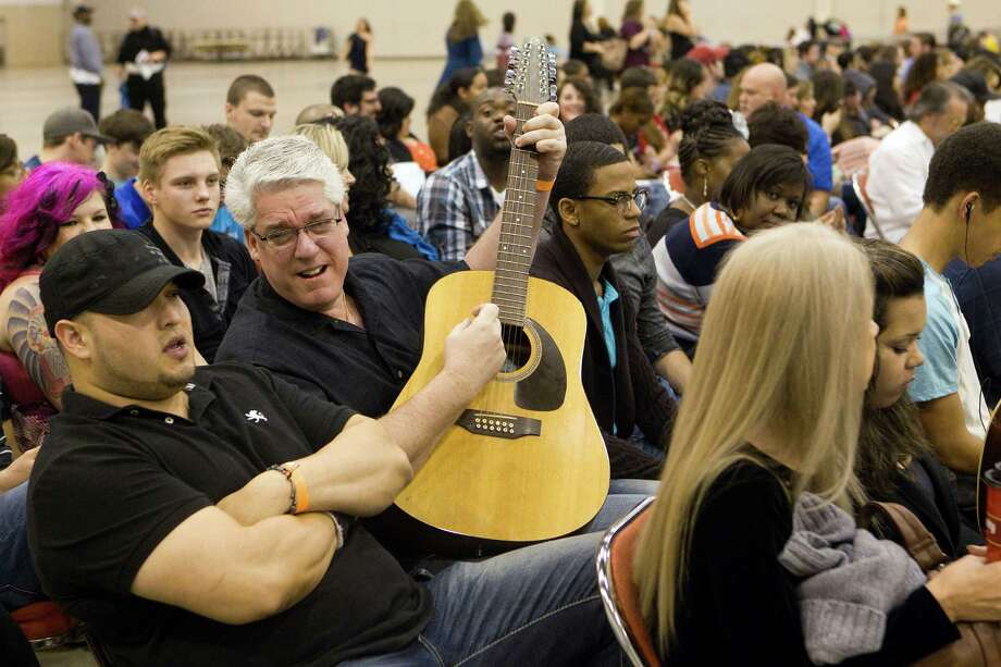 J.J. Arevalo, left, of Houston, and Mitch Washer of Rochester, Mich., sing before auditioning. Photo: Johnny Hanson, Houston Chronicle / © 2013  Houston Chronicle