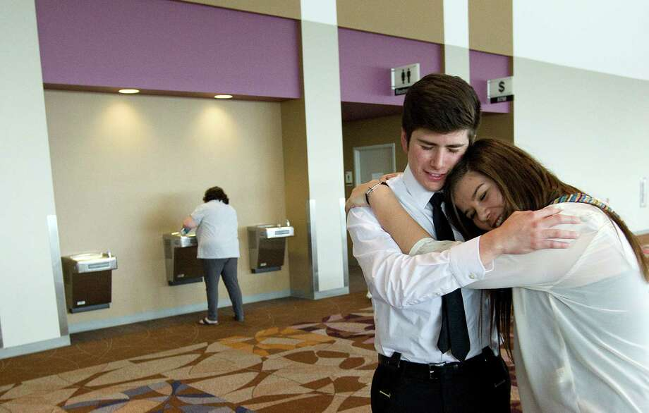 Adolfo Lambert, 19, and his sister Juliet Lambert, 15, of San Antonio give each other a hug after not making it through to the next round. Photo: Johnny Hanson, Houston Chronicle / © 2013  Houston Chronicle