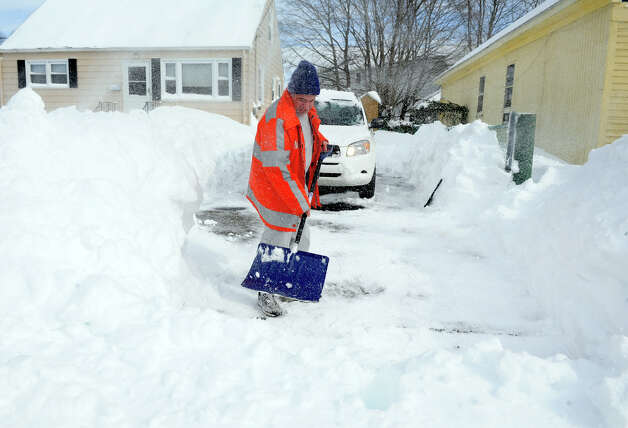 Resdident Ed Valente shovels his driveway after a blizzard pounded the region in West Haven, Conn. on Saturday February 9, 2013. Photo: Christian Abraham / Connecticut Post