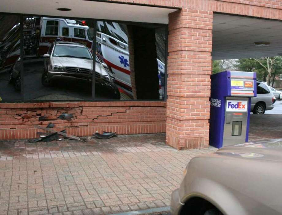 Fairfield Fire, Police & Building Departments respond to SUV into building at 111 Beach Road in Fairfield on Monday December 28, 2009 Photo: Contributed Photo / Connecticut Post Contributed