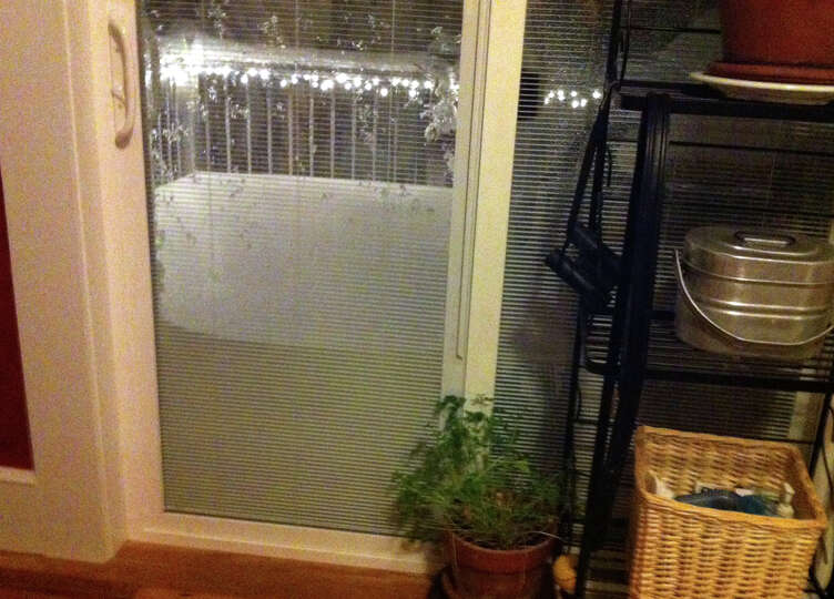 Snow plies up against a glass slider door as a blizzard pounds the region in West Haven, Conn. on Fr