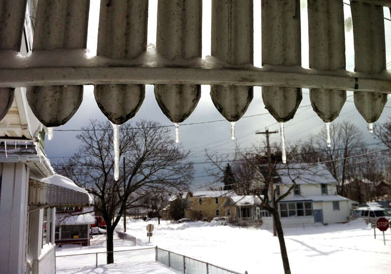 Icicles on an awning after a blizzard pounded the region in West Haven, Conn. on Saturday February 9