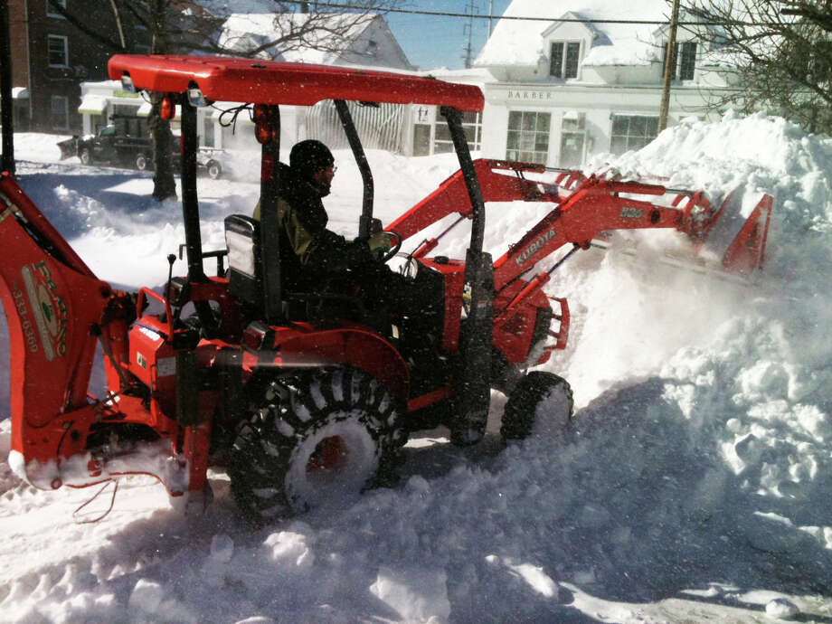 Louis Fratino of Fairfield clears snow from a parking lot in Southport Village on Saturday afternoon. FAIRFIELD CITIZEN, CT 2/9/13 Photo: Andrew Brophy / Fairfield Citizen contributed