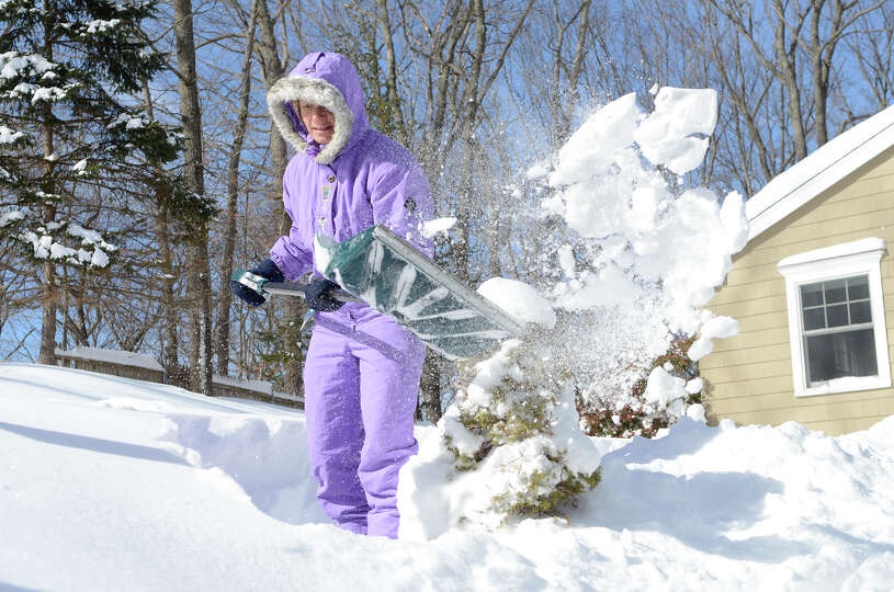 Pascale Butcher shovels her front walkway in Southport, CT on Sat., Feb. 9, 2013, following a blizza