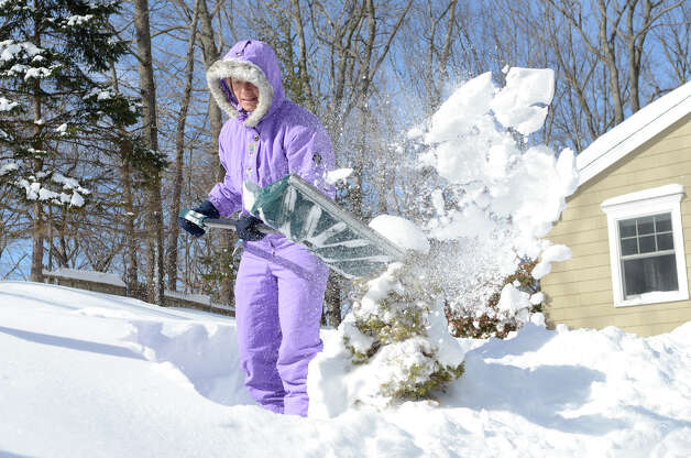 Pascale Butcher shovels her front walkway in Southport, CT on Sat., Feb. 9, 2013, following a blizzard that dumped up to three feet of snow across the state. Butcher, head coach at Fairfield's Trifitness and a triathlete and Ironman competitor, said she was happy to get a good workout and a chance to get some use out of a warm snowsuit she's had since the '80s. Photo: Shelley Cryan / Shelley Cryan for the CT Post/ freelance Shelley Cryan