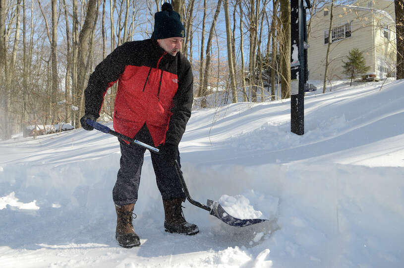 Ken Moore clears the snow from his driveway in Southport, CT on Sat., Feb. 9, 2013, following a bliz