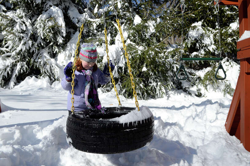 Molly Coccaro, 7, enjoys the snow in her backyard in Southport, CT on Sat., Feb. 9, 2013, following