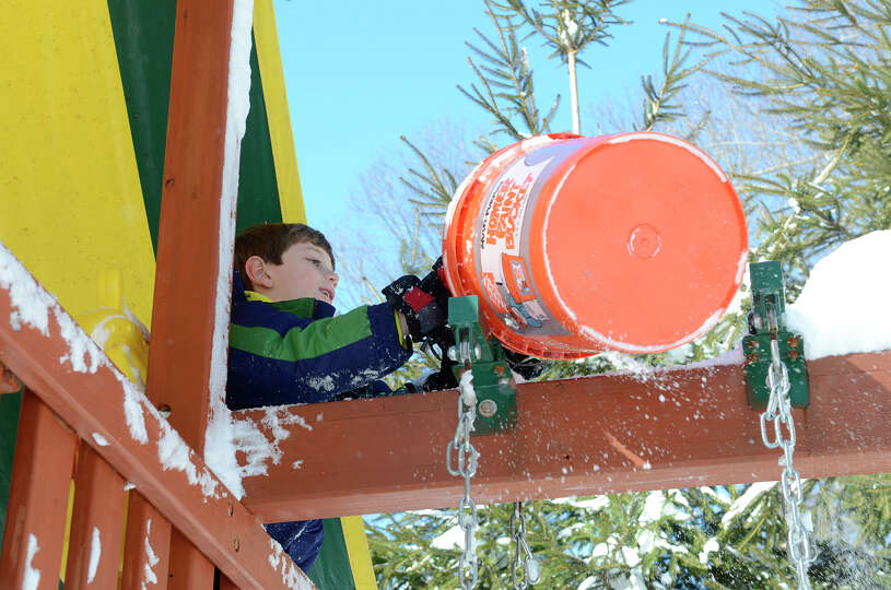 Ryan Tymon, 7, plays in a neighbor's backyard in Southport, CT on Sat., Feb. 9, 2013, following a bl