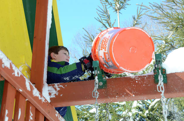 Ryan Tymon, 7, plays in a neighbor's backyard in Southport, CT on Sat., Feb. 9, 2013, following a blizzard that dumped up to three feet of snow across the state. Photo: Shelley Cryan / Shelley Cryan for the CT Post/ freelance Shelley Cryan