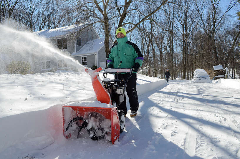 Bret Factora clears his driveway in Southport, CT on Sat., Feb. 9, 2013, following a blizzard that d