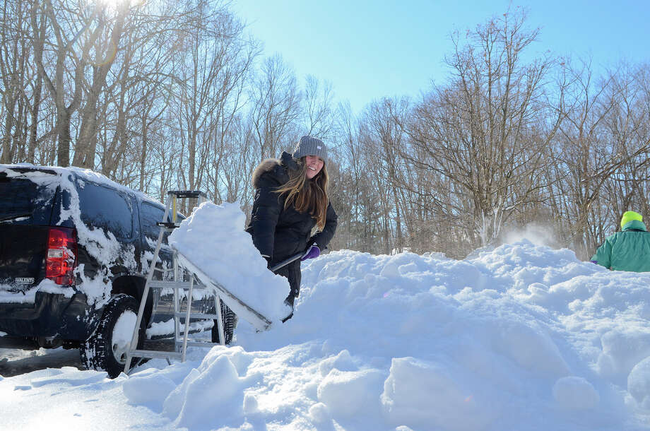 Ana Wyckoff, 16 next week, helps shovel her family's driveway in Southport, CT on Sat., Feb. 9, 2013, following a blizzard that dumped up to three feet of snow across the state. Earlier, Ana and her mom had used the ladder in the background to clear off the top of the family car. Photo: Shelley Cryan / Shelley Cryan for the CT Post/ freelance Shelley Cryan
