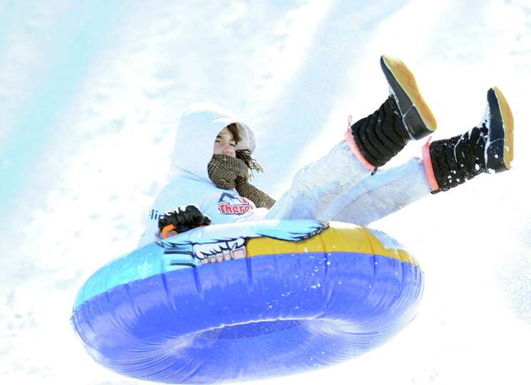A girl on a sled jumps over a ramp on the hill near the Western Greeenwich Civic Center during the a